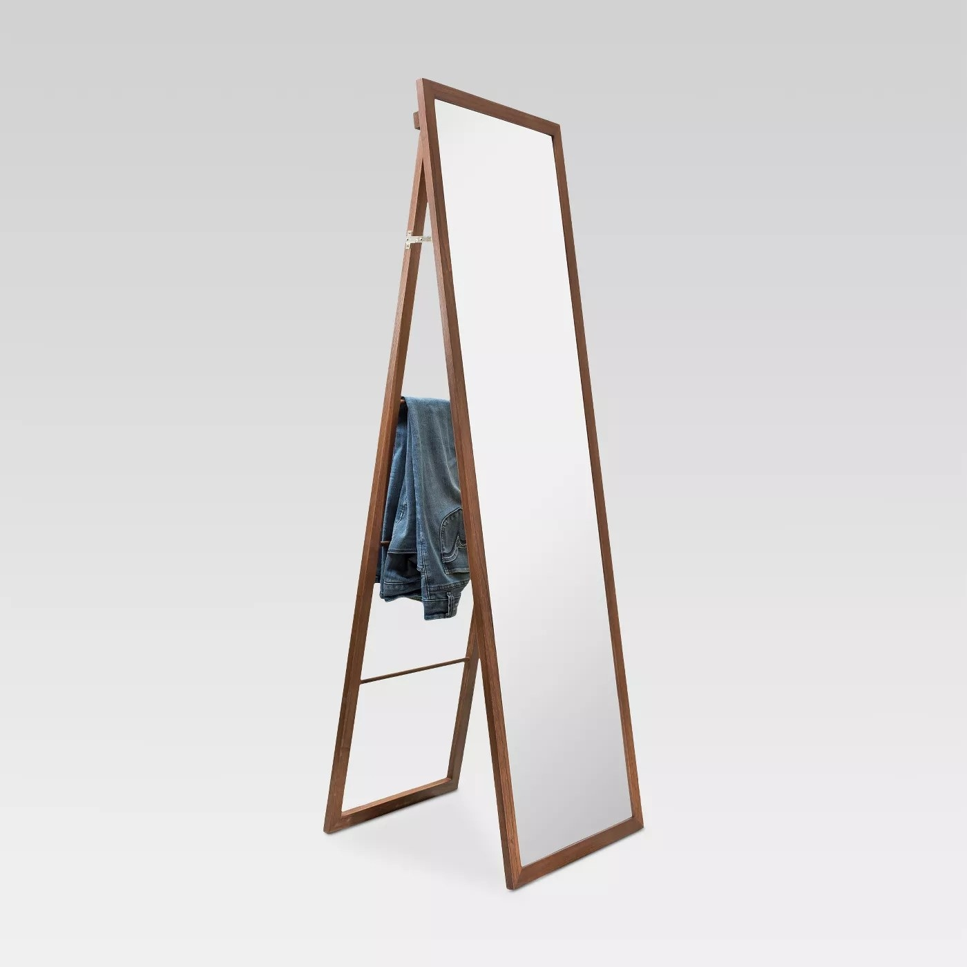 The mirror with a ladder attached to the back that can hold clothes