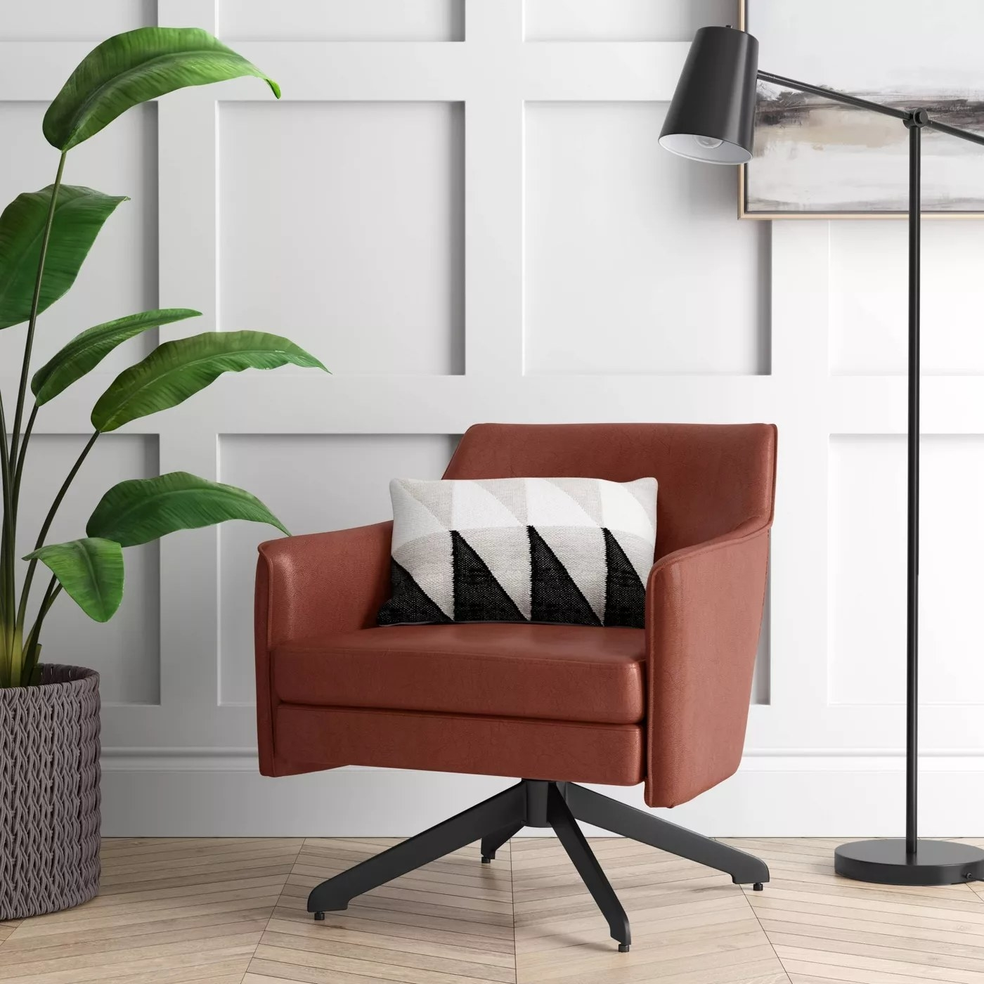 The brown chair with a black swivel base in a living room