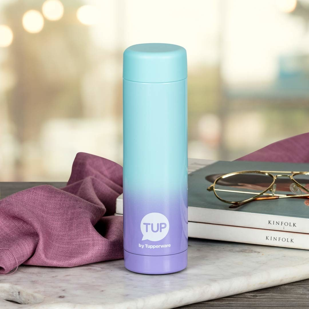 A blue purple flask on a table
