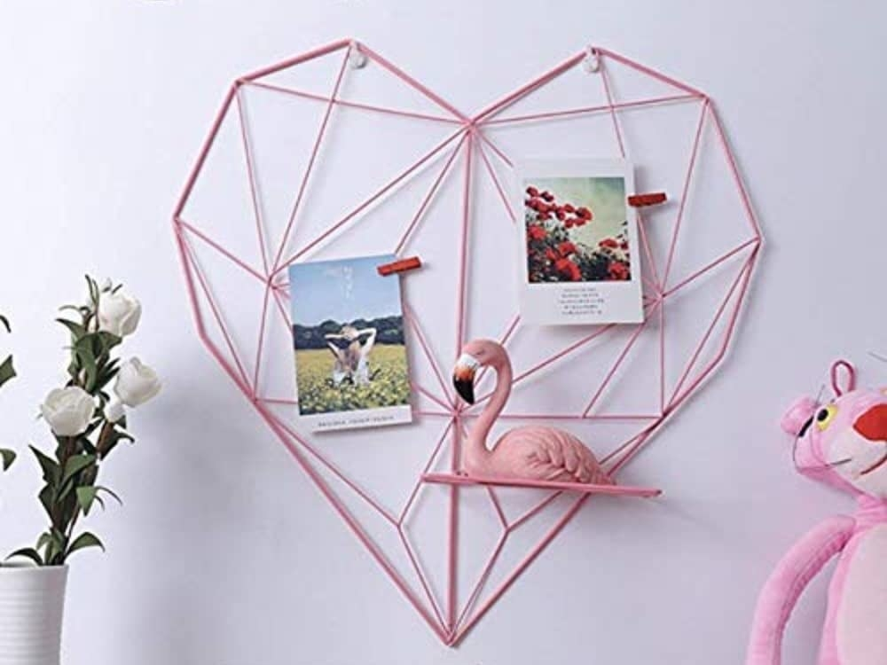 A heart-shaped grip with photographs and a flamingo in it