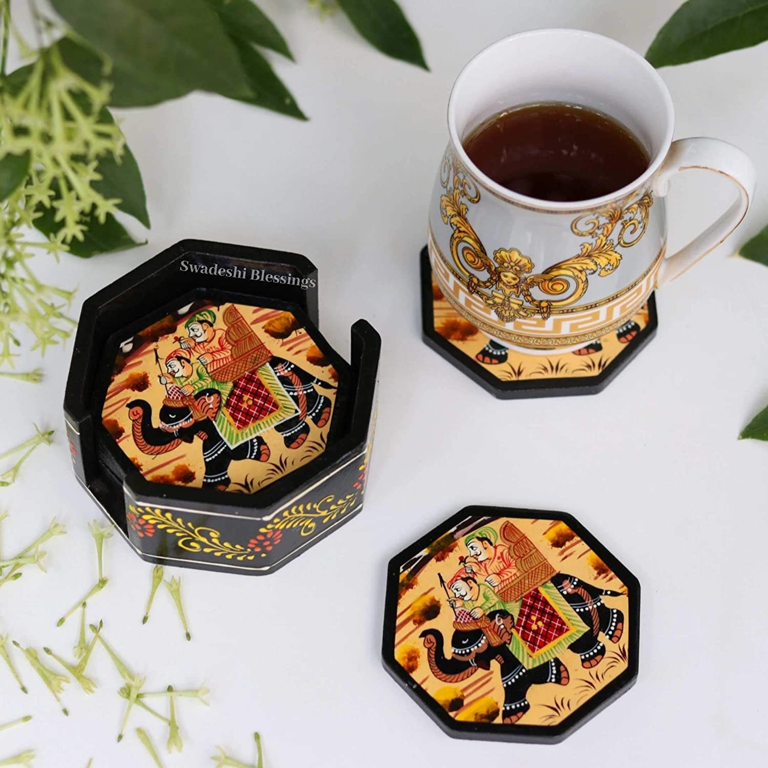 A set of coasters with traditional paintings of royalty on them