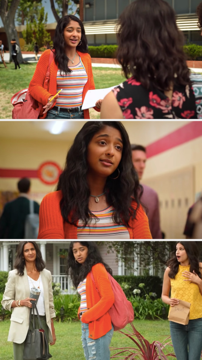 Devi wearing an orange cardigan, stripe tank top, and some distressed blue jeans