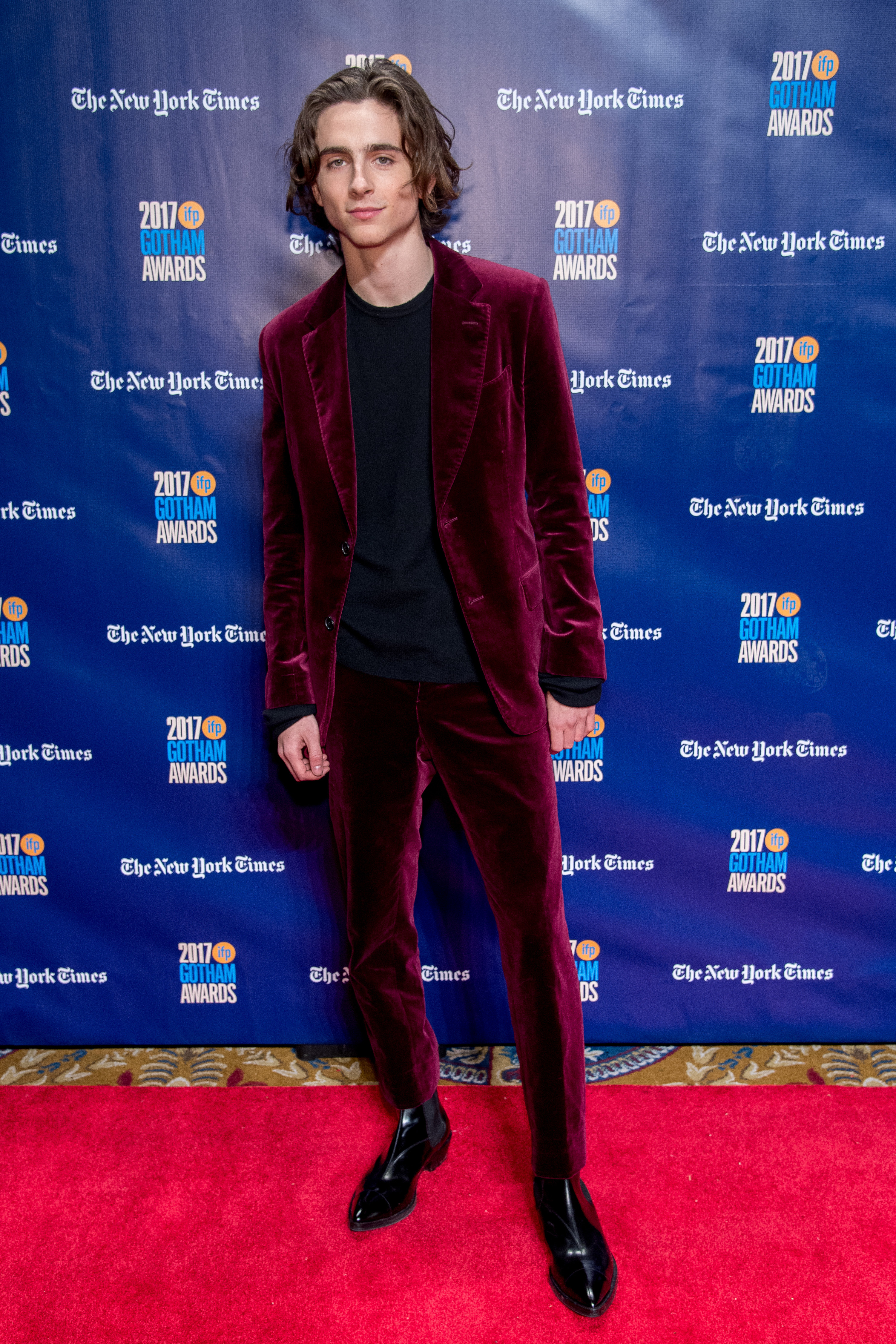 Timothée wears a maroon velvet suit