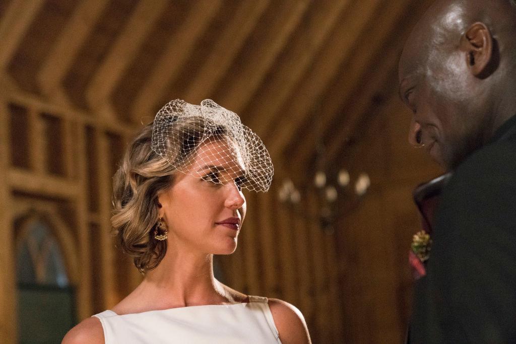 Woman wearing a bridal tiara and looking at a man