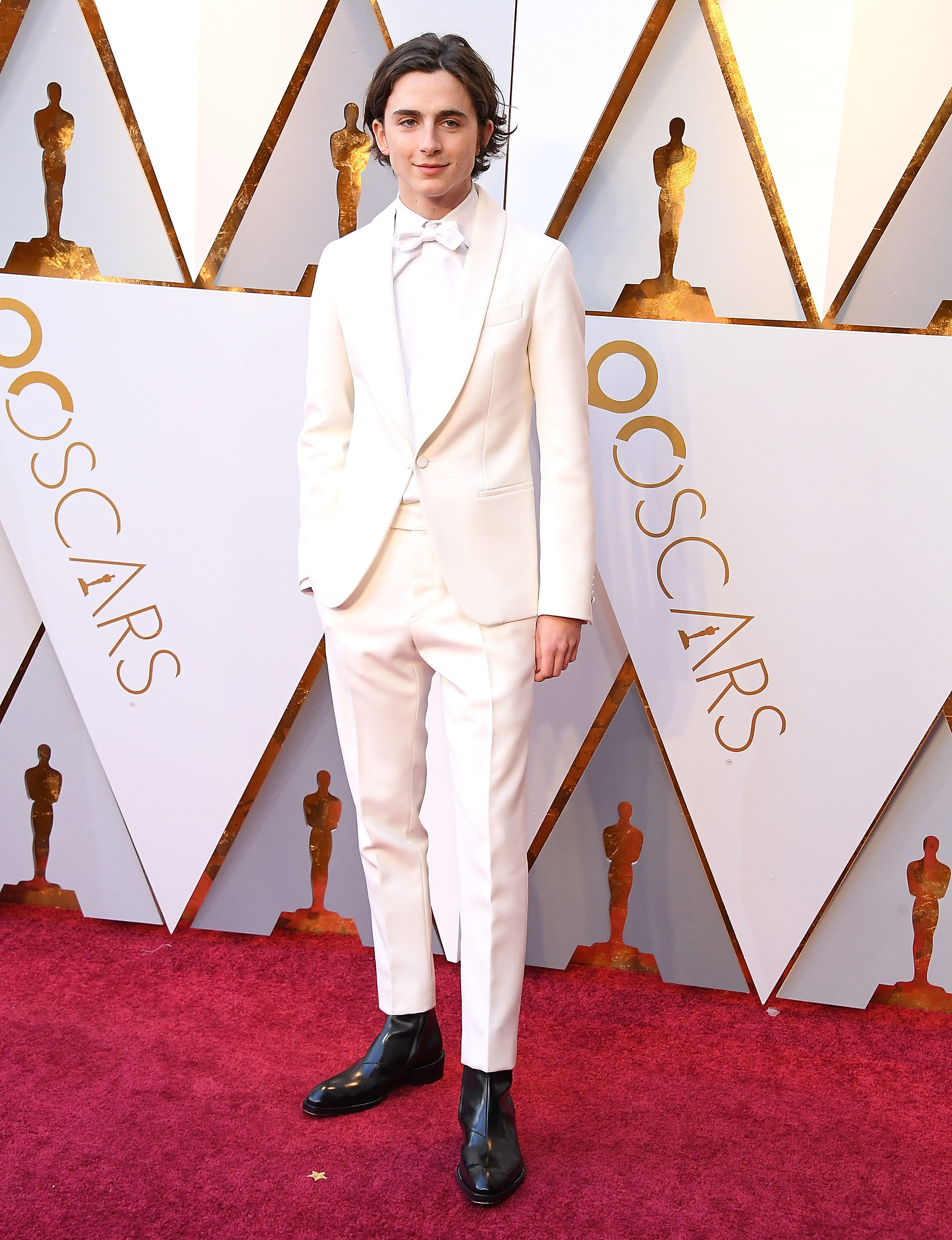 Timothée wears an ivory suit with matching shirt and bow tie