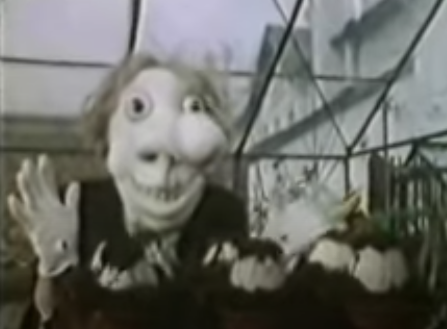 Noseybonk, a deformed creature in a greenhouse