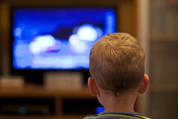 A child watching TV at night