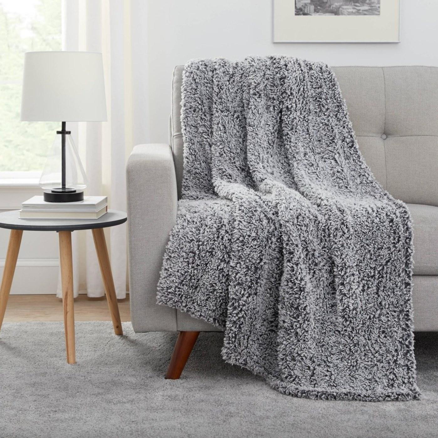 the lightweight sherpa blanket in gray