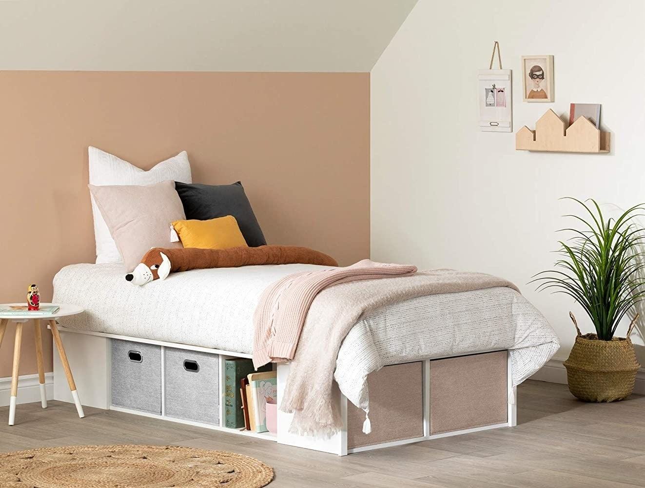 a bed on the storage bed frame in a cute room