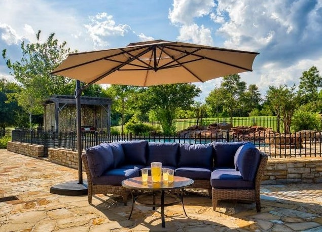 An image of an 11-foot patio umbrella with base
