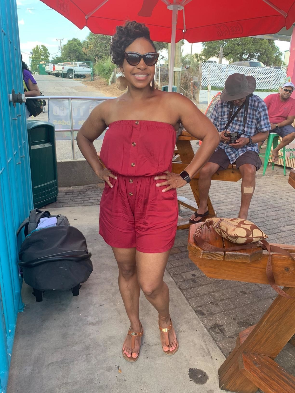 image of reviewer wearing the wine colored strapless romper in a size medium