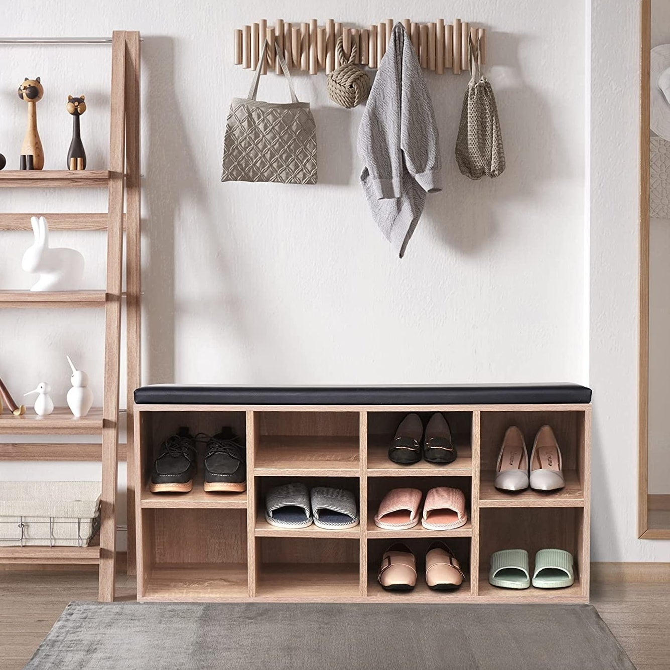 a shoe bench shelf with shoes in them
