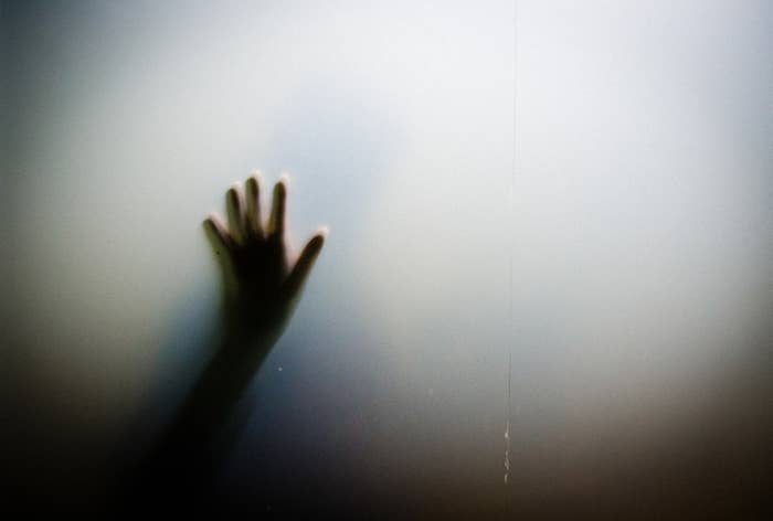 creepy shadow hand reaching out