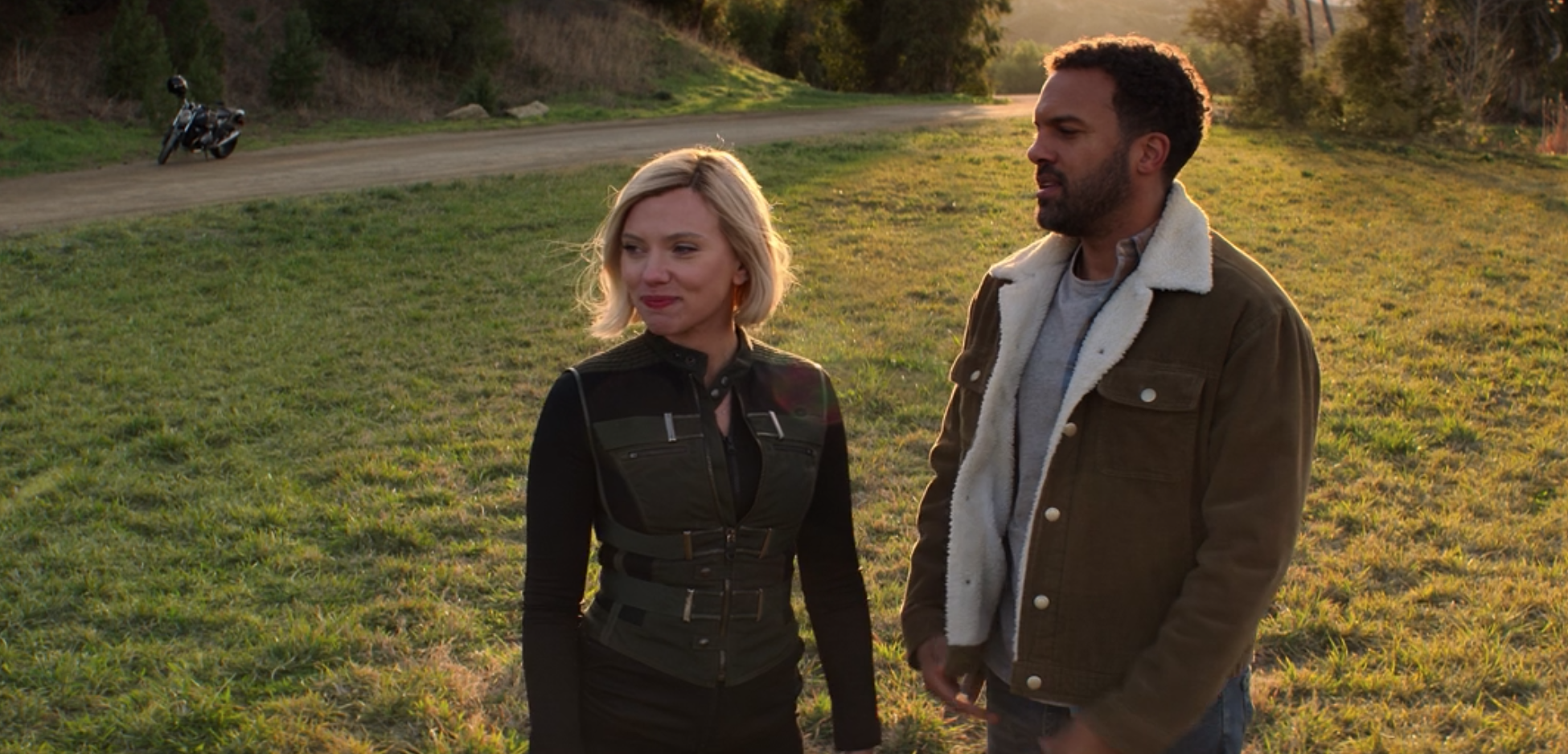 Natasha Romanoff and Rick Mason stand side by side in a sunlight field
