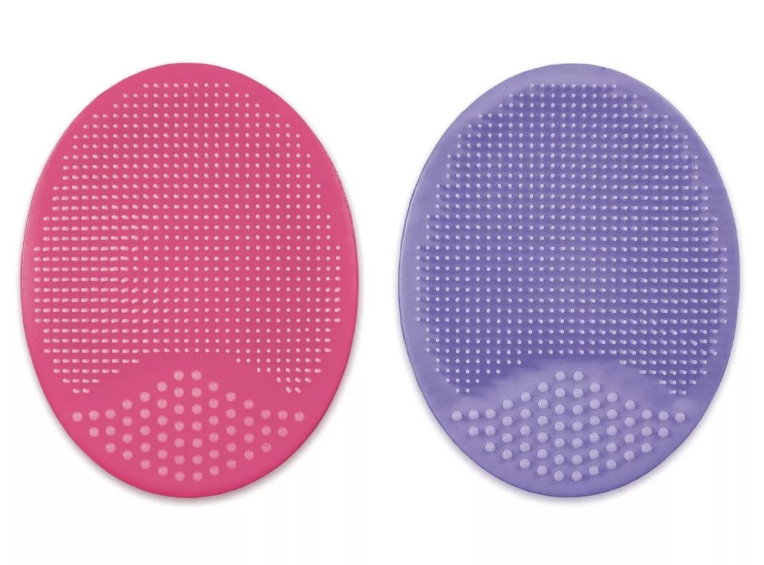 a set of purple and pink silicone scrub pads