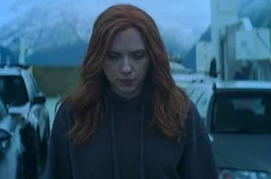 Natasha Romanoff walks across a car boat with her gaze pointed downwards