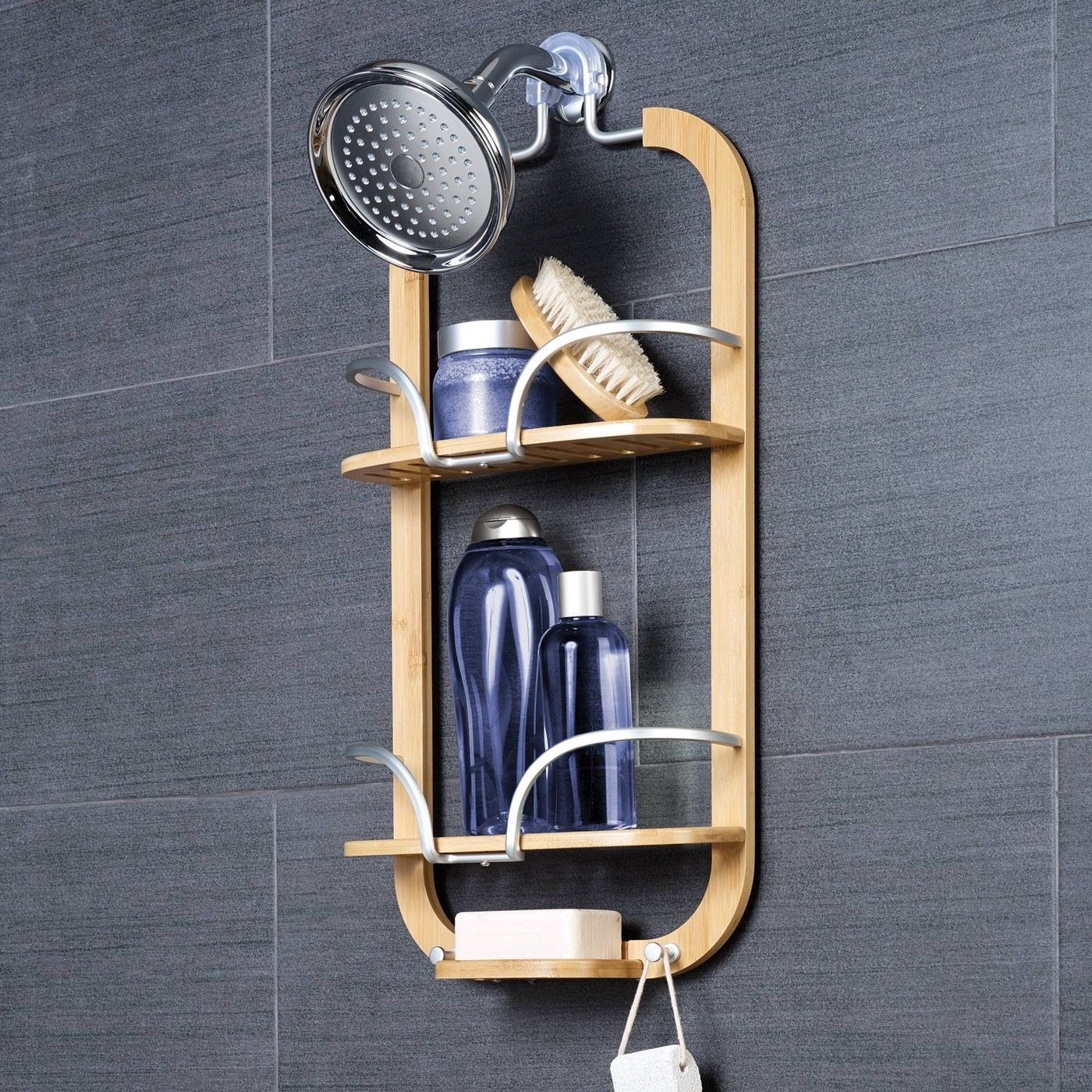 a bamboo and metal shower caddy hanging on a shower head