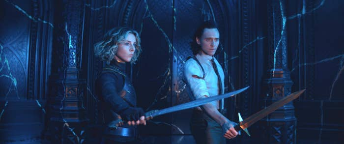 Sylvie and Loki holding swords, ready to fight