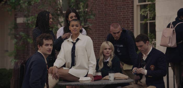 """The characters of """"Gossip Girl"""" hanging out in the school courtyard"""