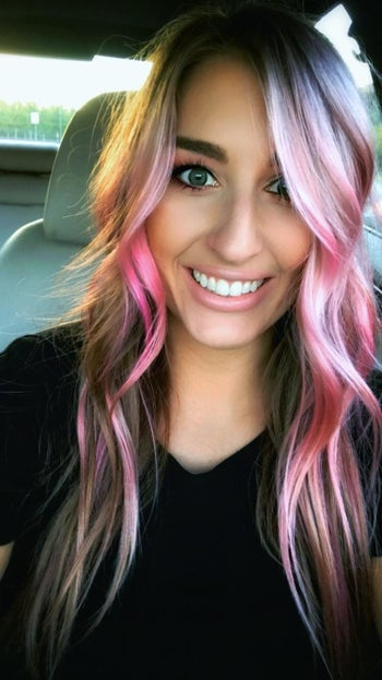 Reviewer with pink hair from using product