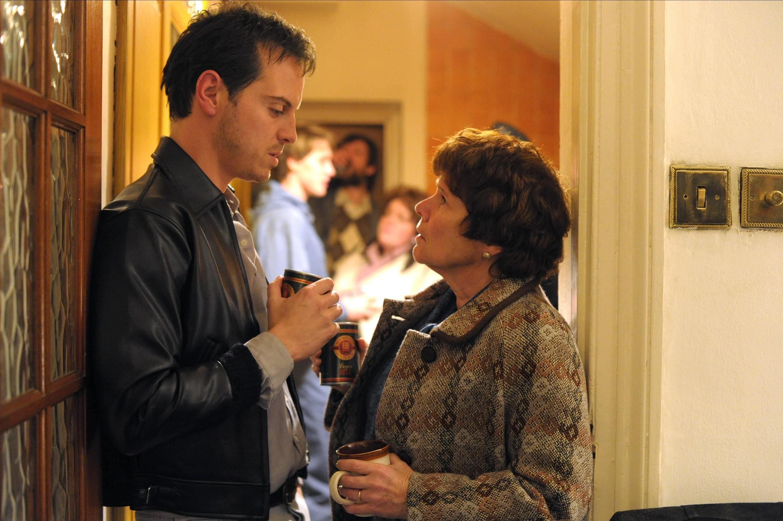 Imelda Staunton and Andrew Scott talk in a doorway