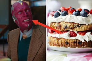 Vision has his head turned to the side as he's mid sentence and a two layered frosted cake with strawberries and blueberries on top