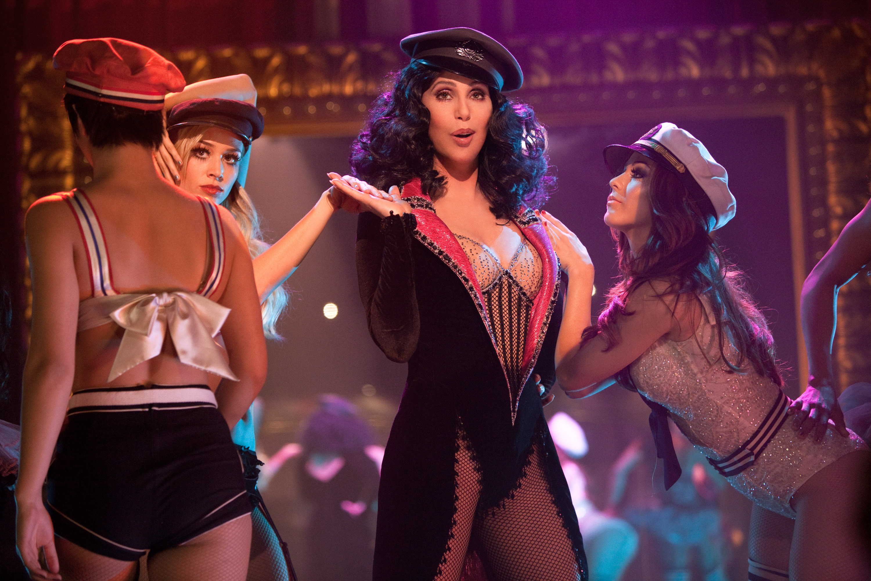 Cher performs on a burlesque stage