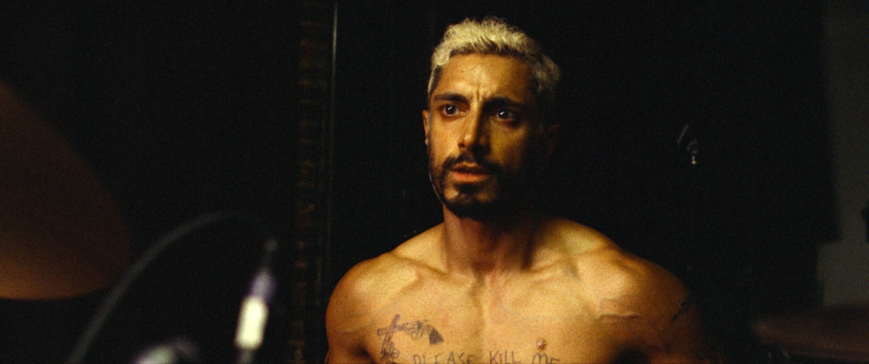 Riz Ahmed plays the drums shirtless