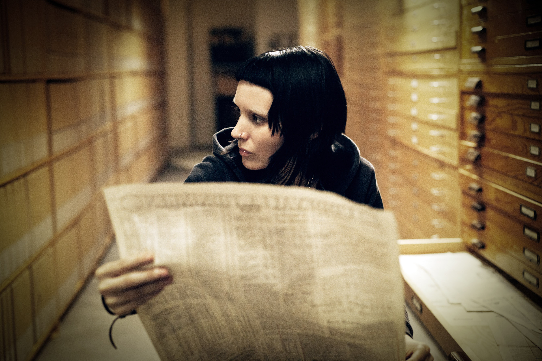 Rooney Mara reads a newspaper