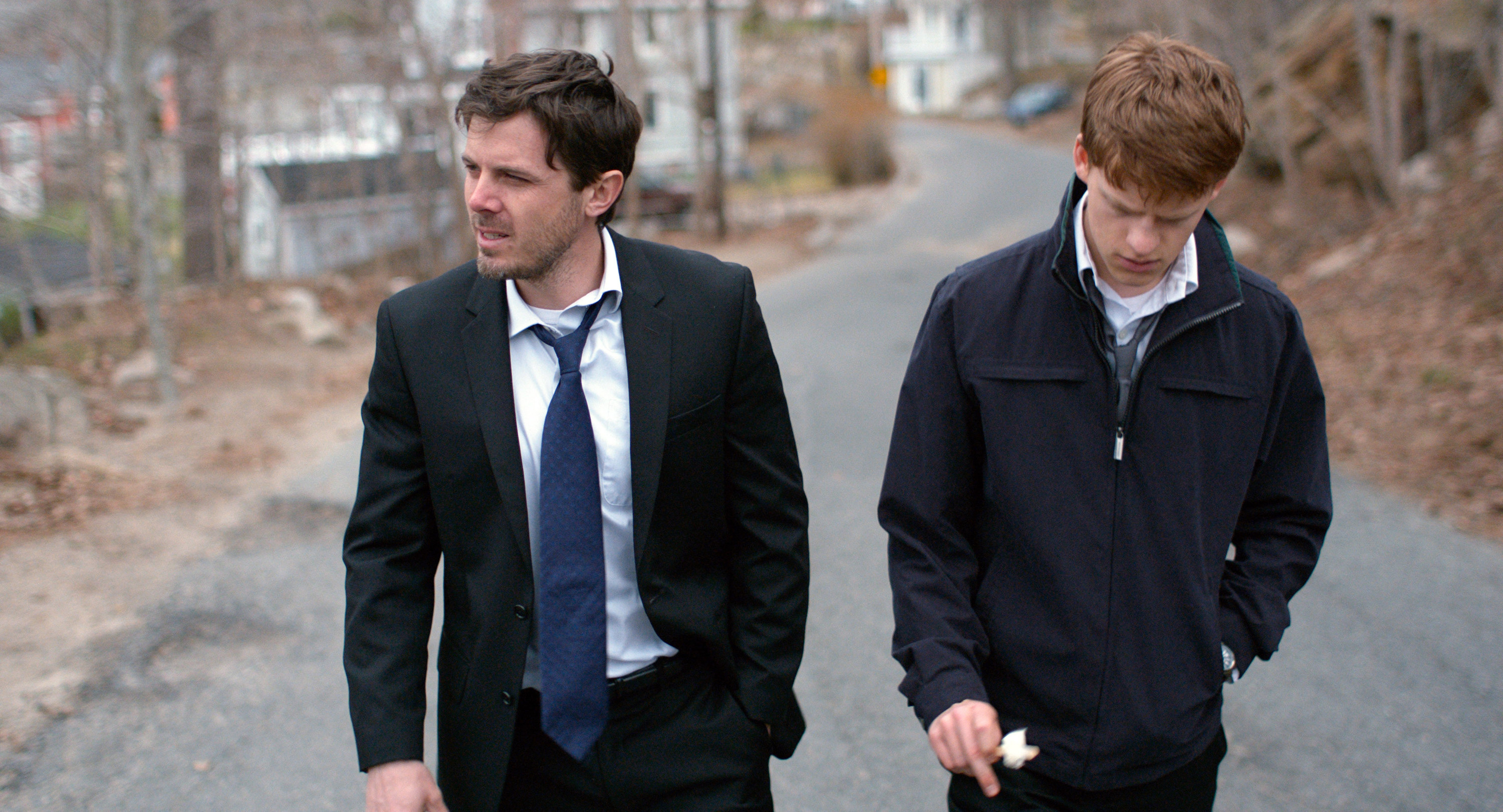 Case Affleck and Lucas Hedges walk down a road