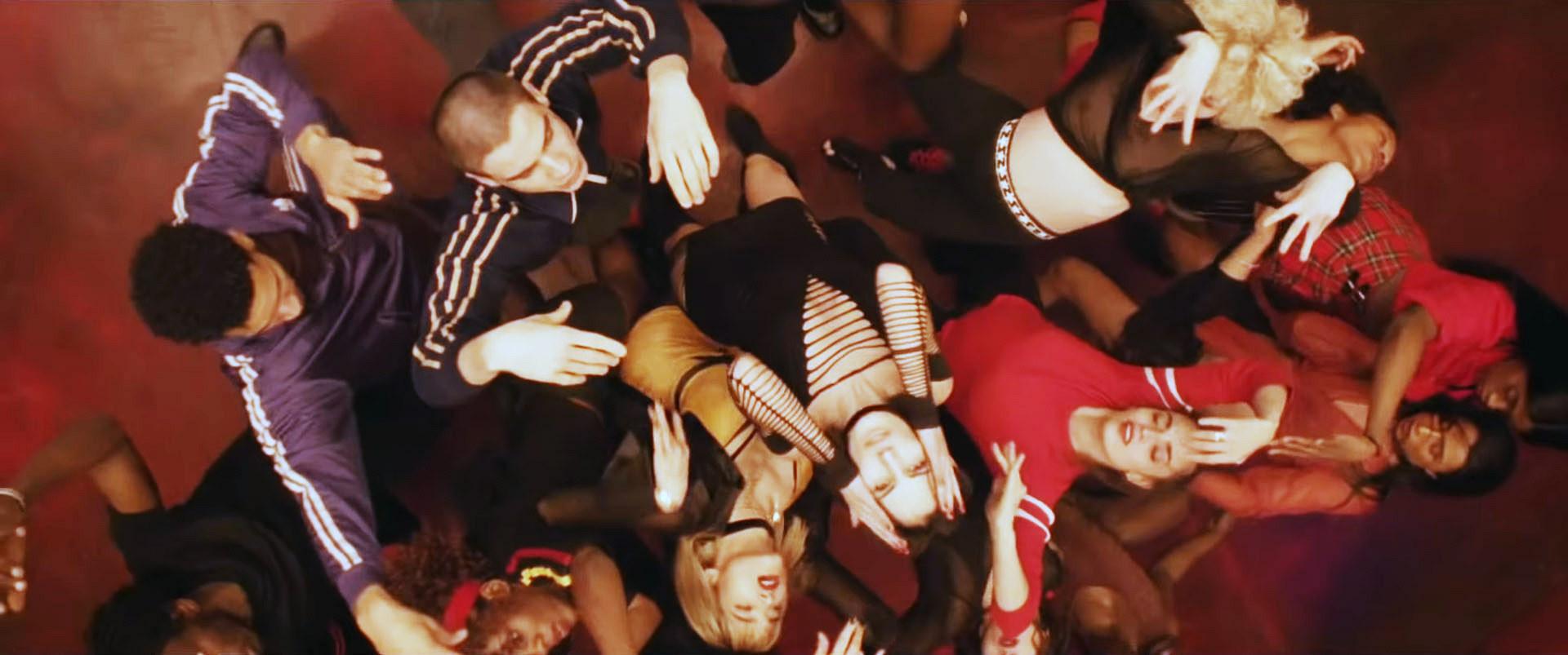 Romain Guillermic, Sharleen Temple, Gizelle Palmer, Sarah Bella, Lea Vlamos, and Sofia Boutella all dance in a circle
