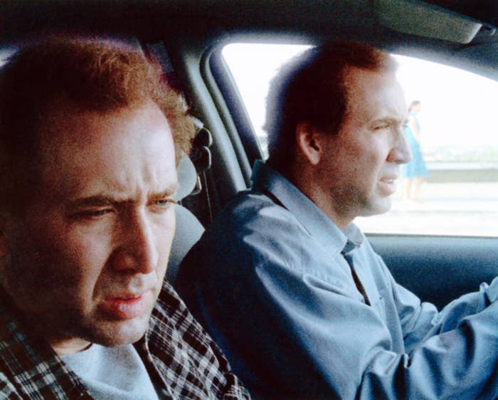 Two Nicolas Cages riding in a car