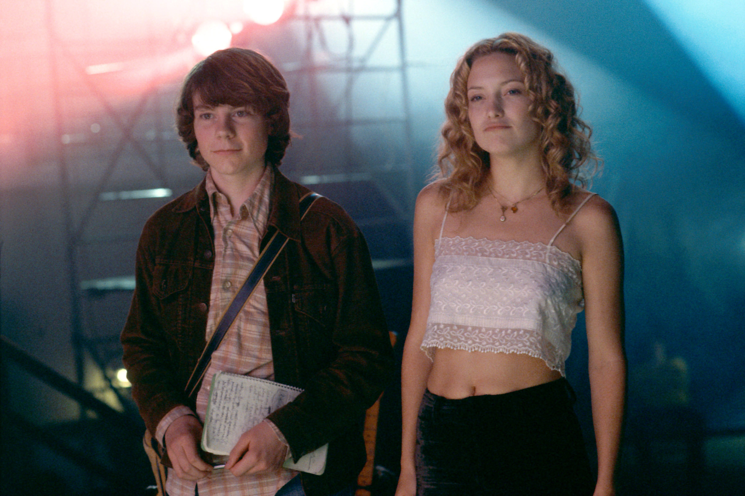 Patrick Fugit and Kate Hudson stand backstage a concert