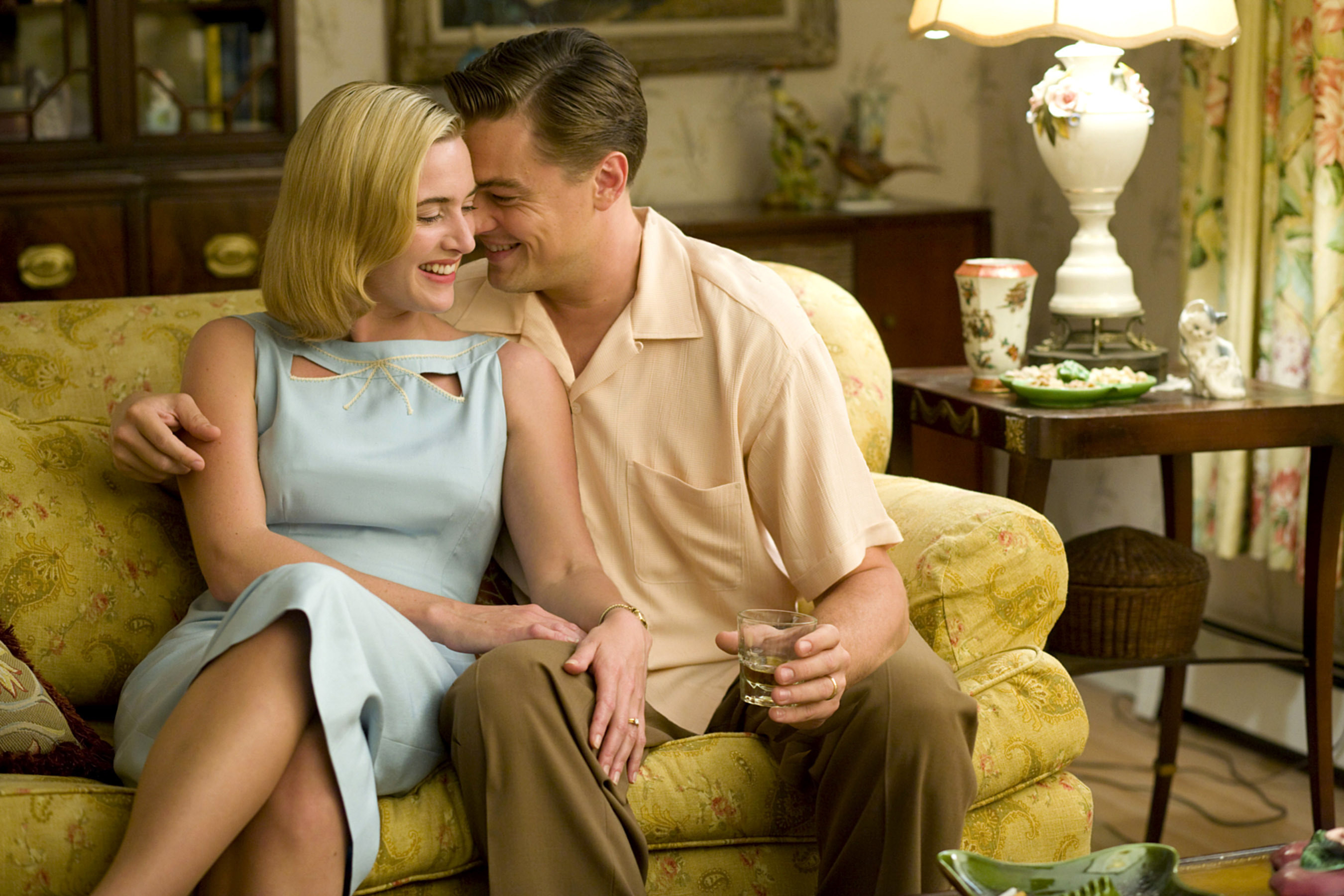 Kate Winslet and Leonardo DiCaprio get cozy and laugh on a couch