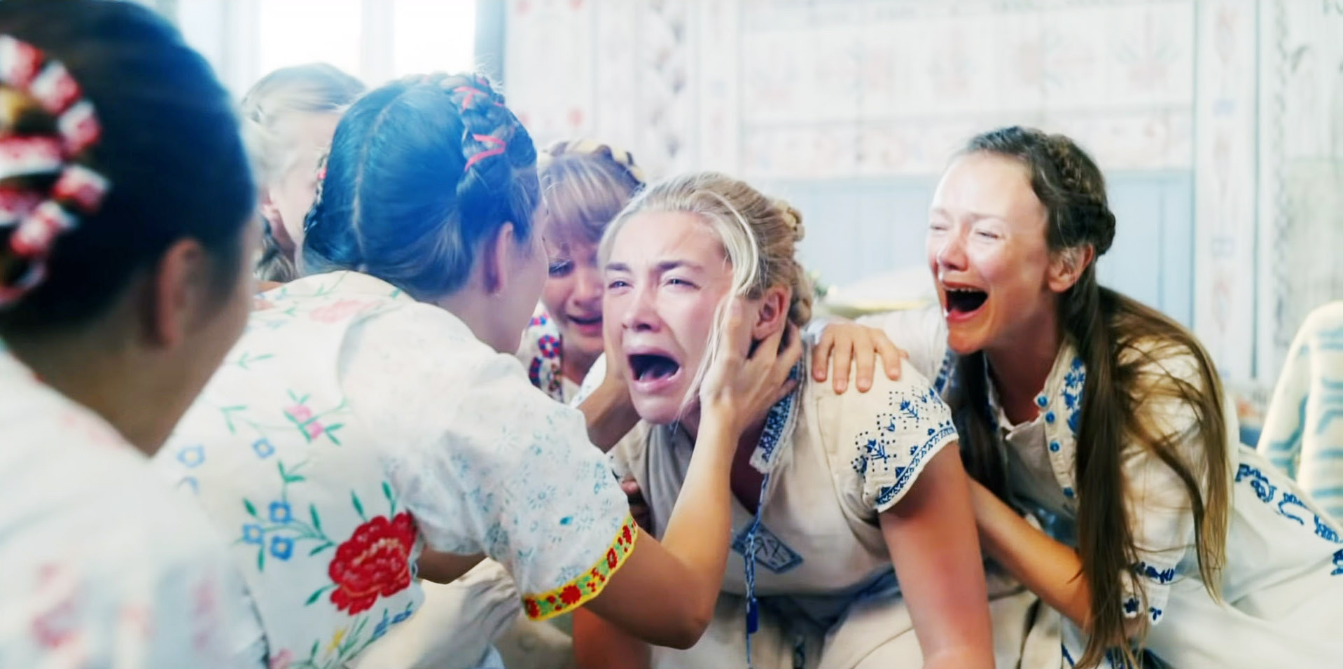 Florence Pugh crying with a bunch of women surrounding her