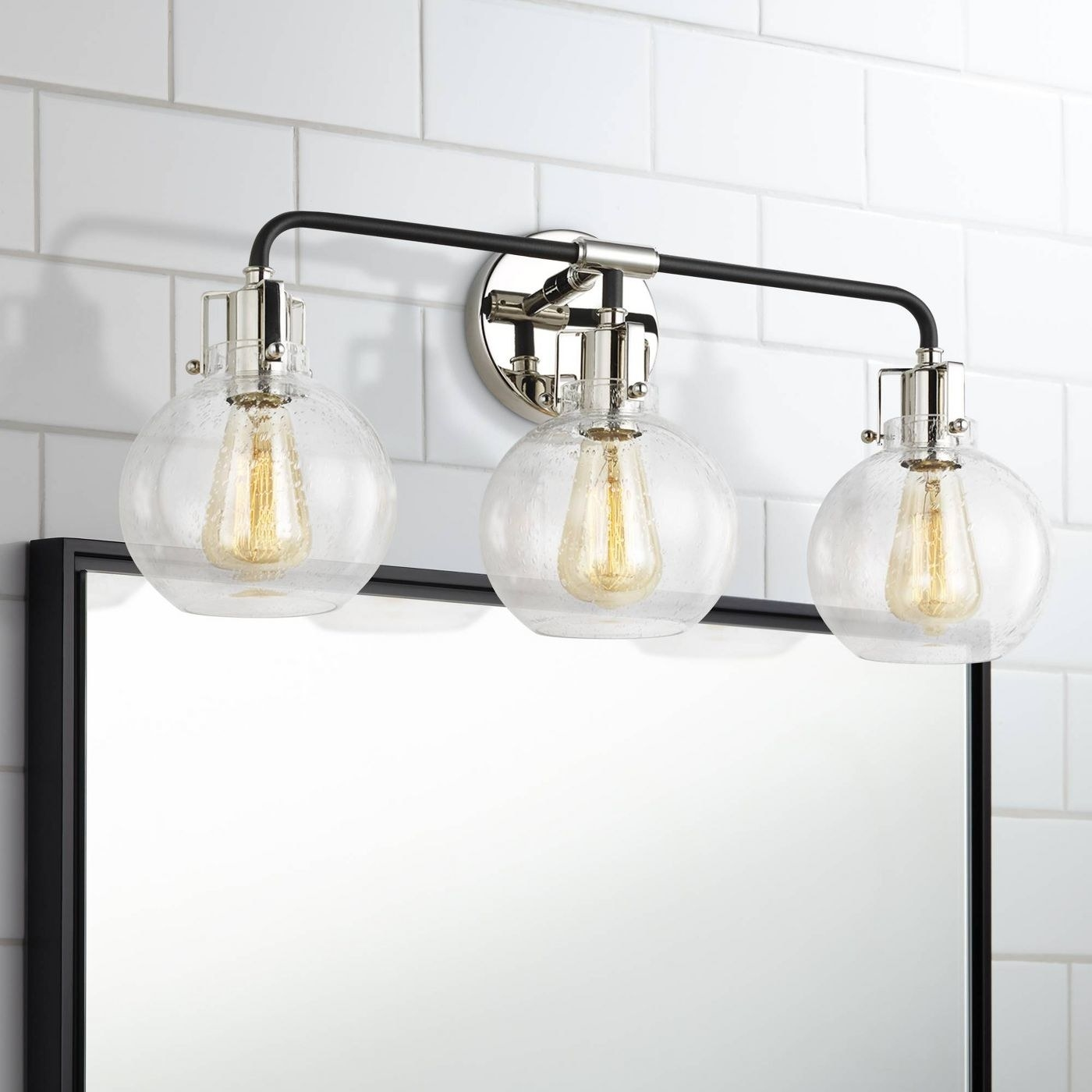 a mounted vanity light with three bulbs