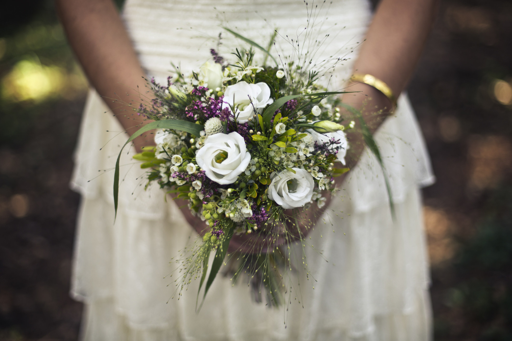 Bride holding a small bouquet