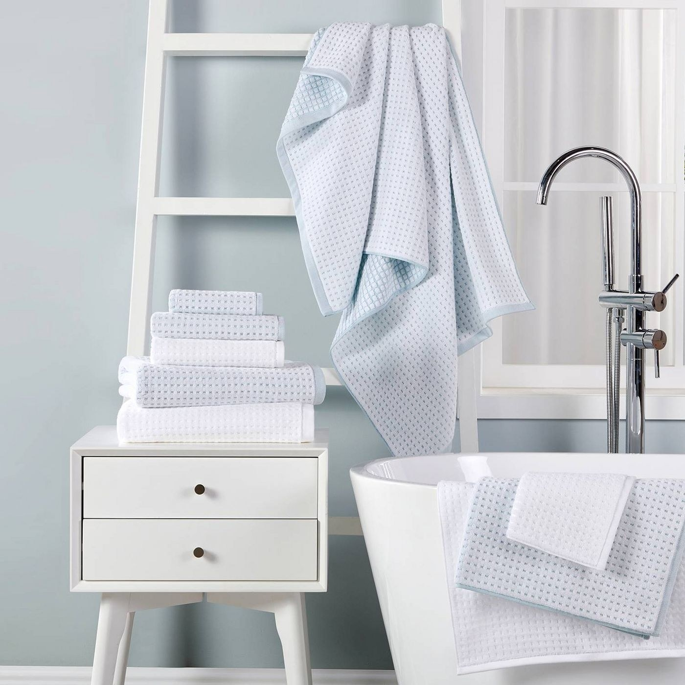 blue and white towels in a bathroom