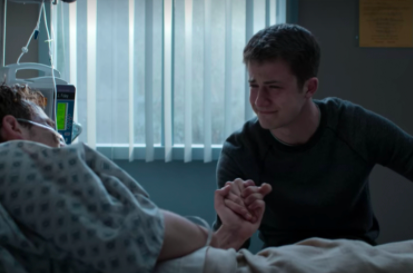 Clay holding Justin's hand as he's dying in the hospital bed