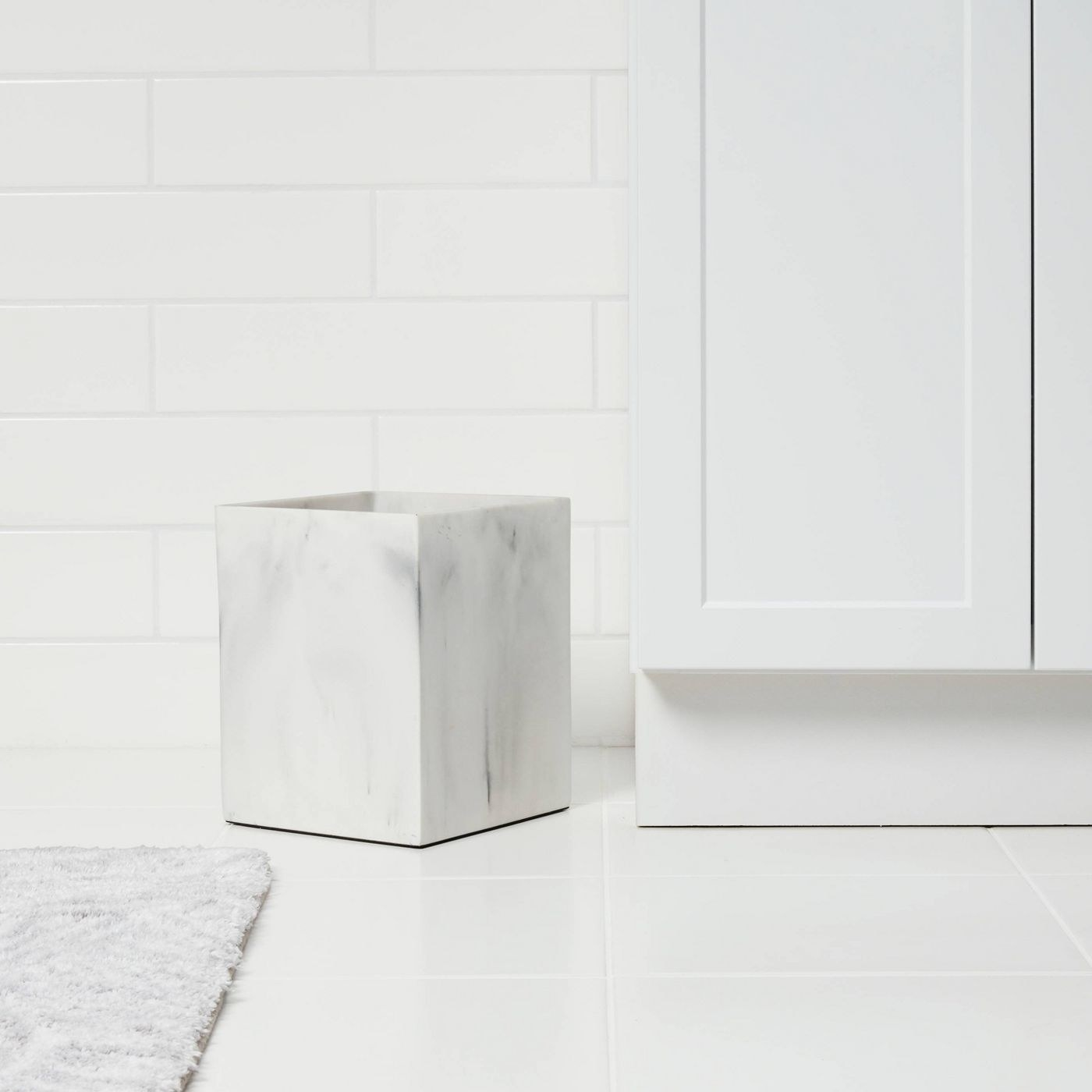 a marble-printed square trash can