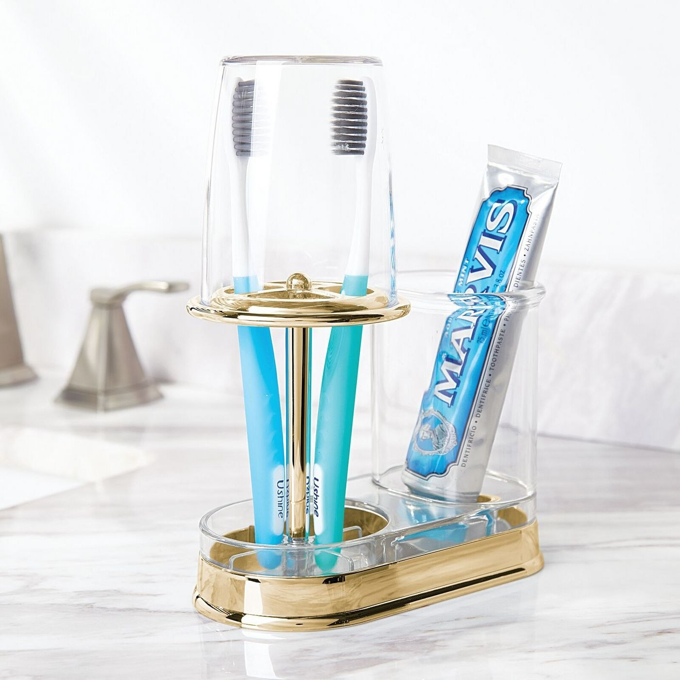 a god toothbrush, toothpaste, and rinse cup holder