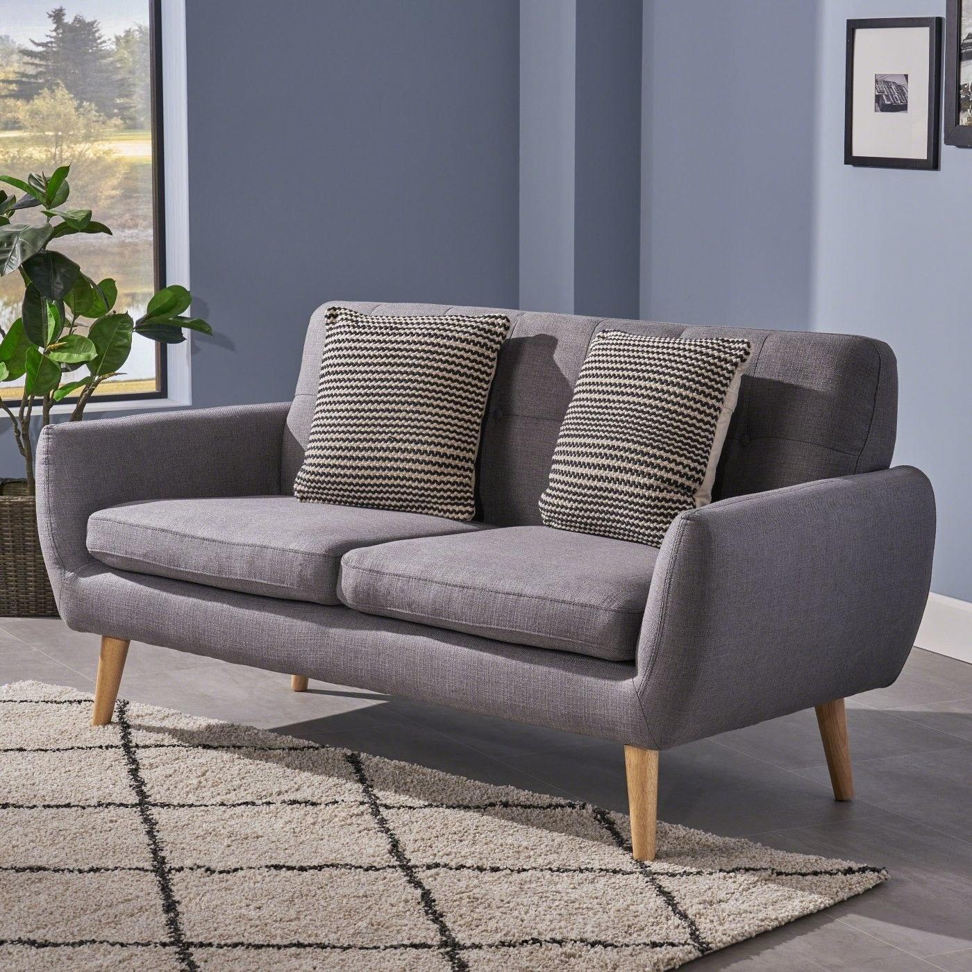grey mid-century modern sofa with wooden legs