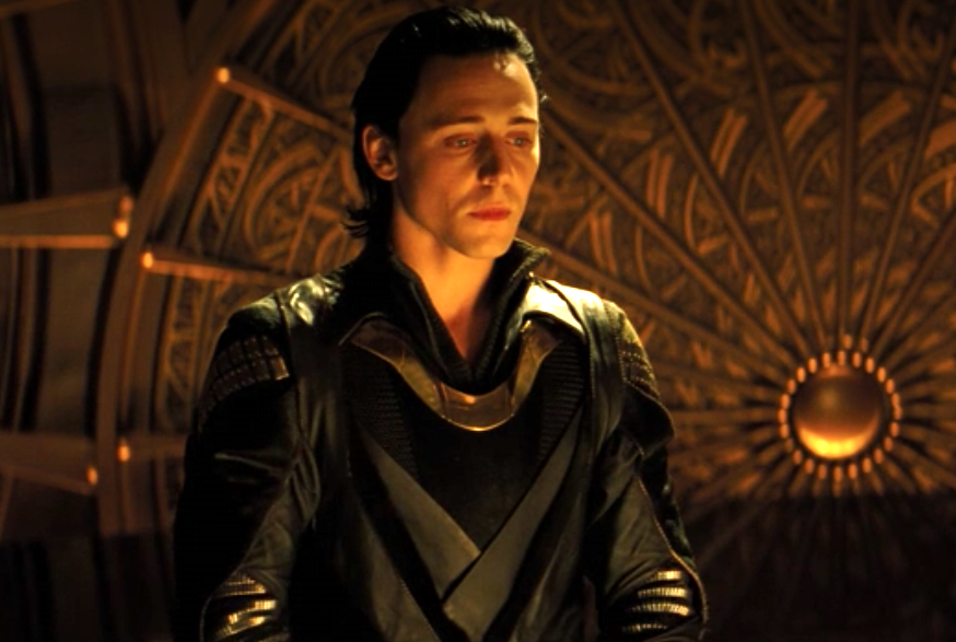 Loki looking pensive, his costume with ornate curves and interweaving designs