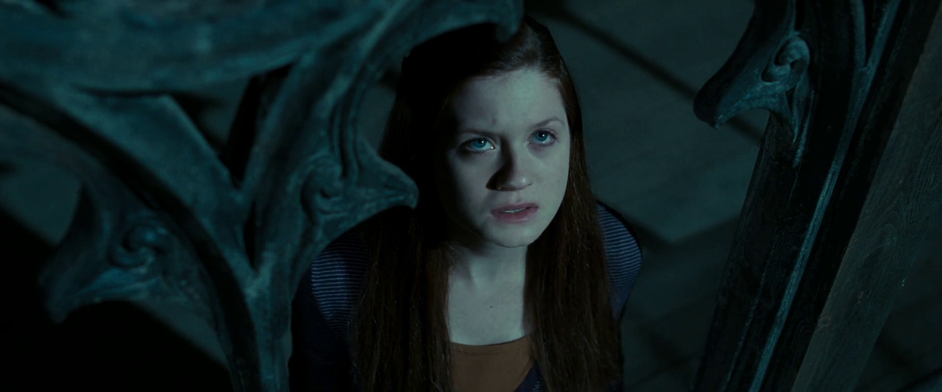 Ginny looking up at someone during the battle of Hogwarts