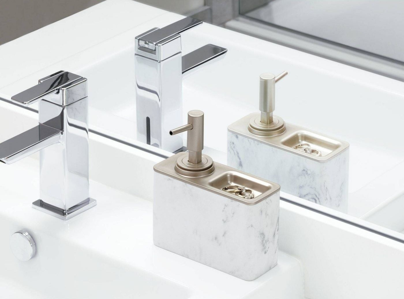 a marble and gold soap dispenser with a ring dish