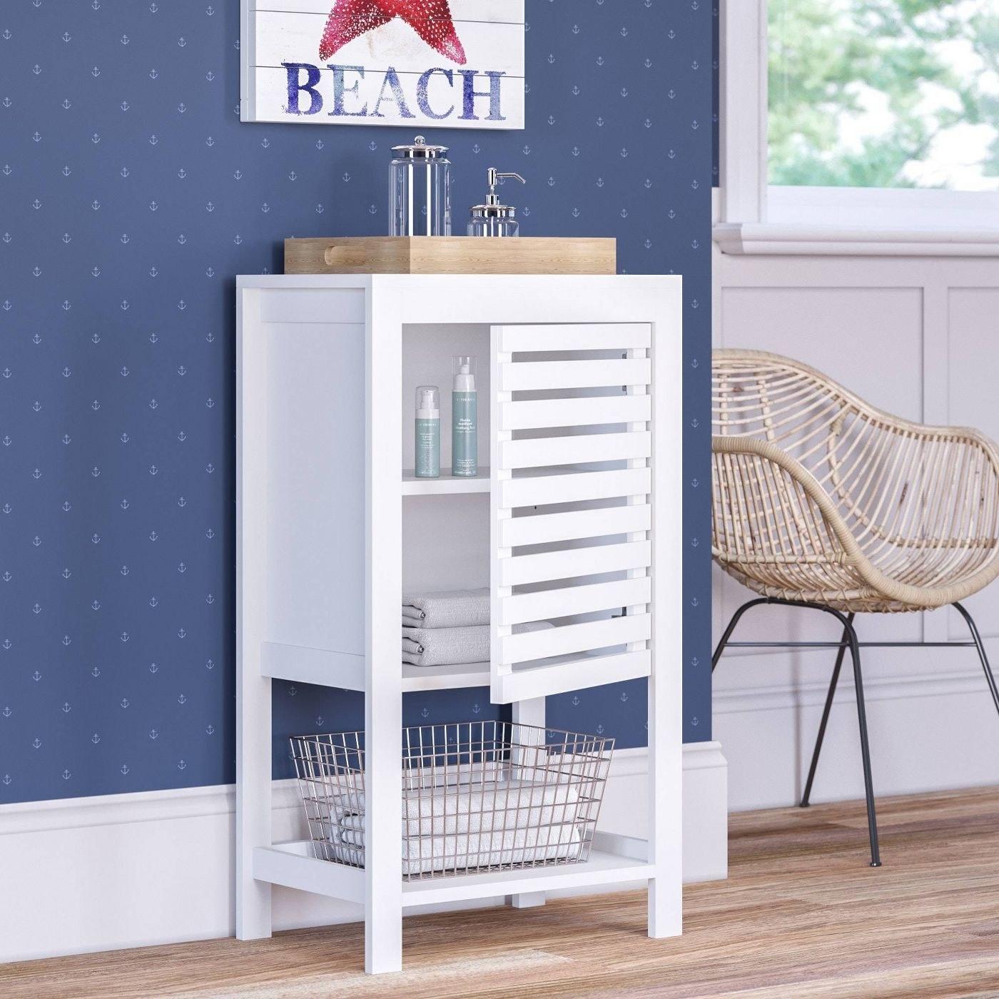 a white wooden linen cabinet