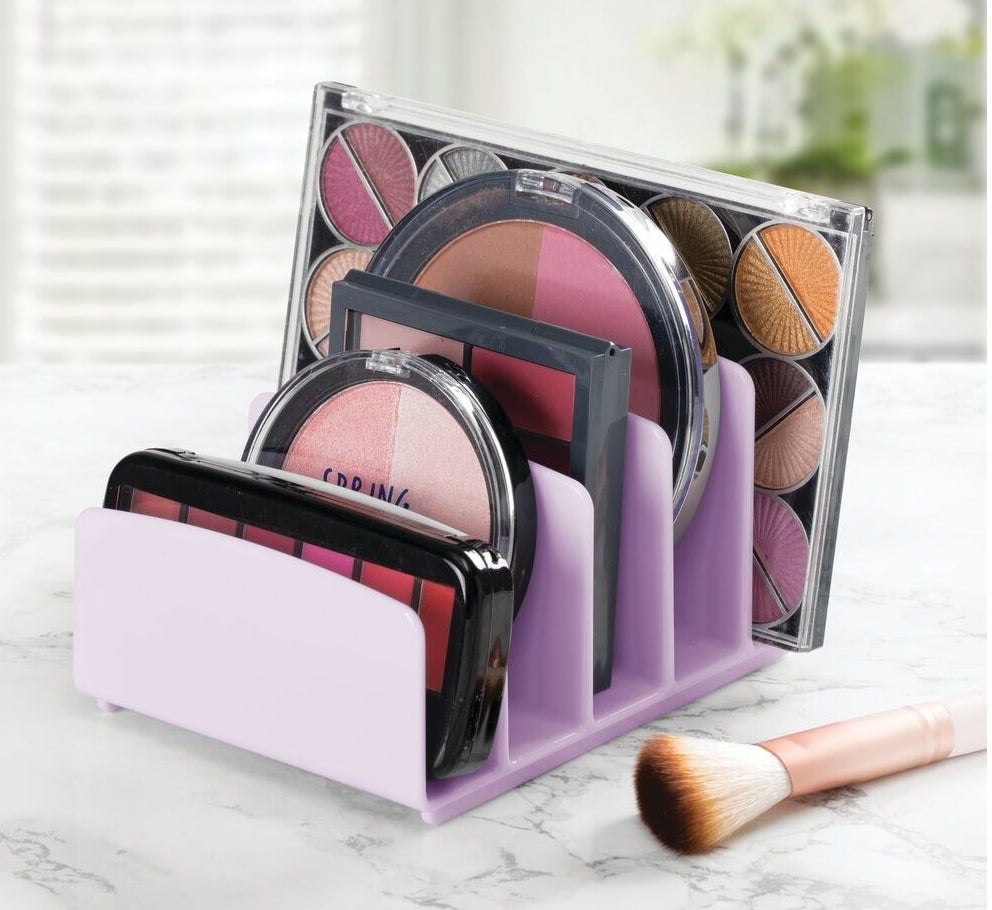 a lilac five slotted organizer with makeup palettes