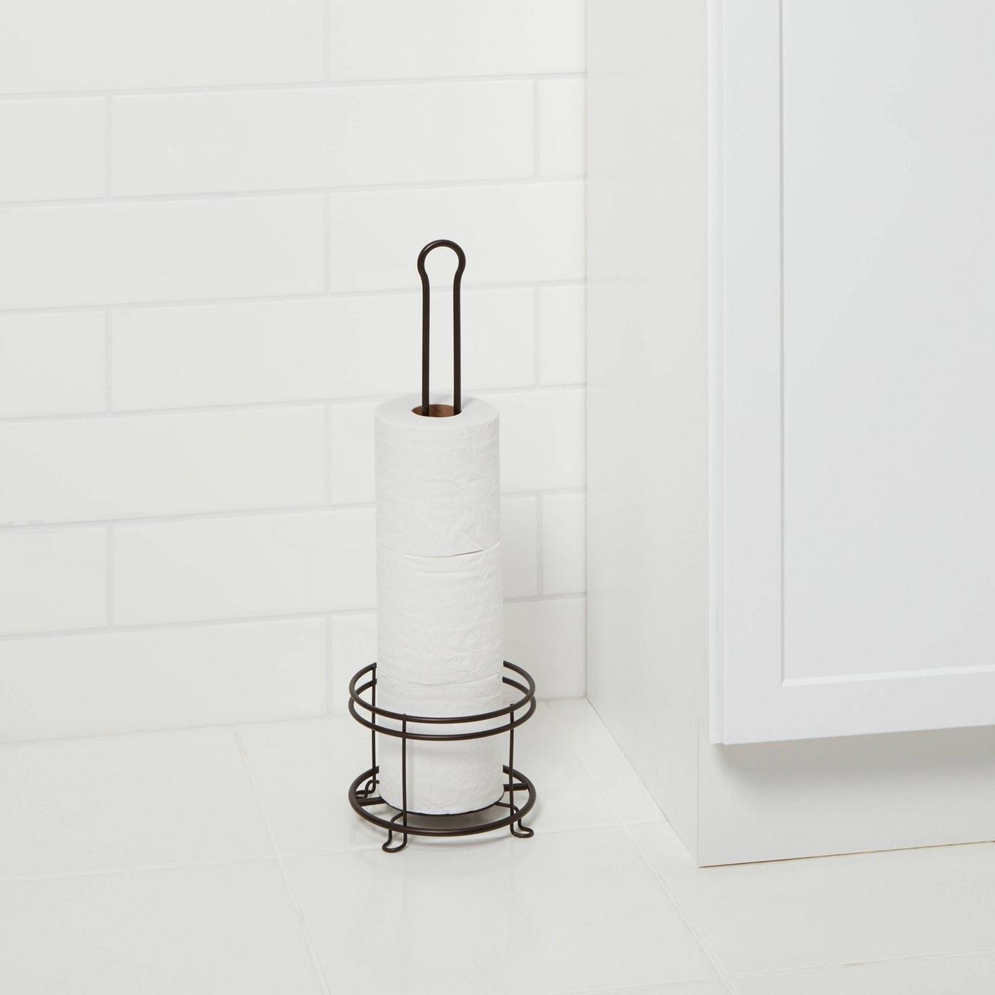 a matte black toilet paper holder
