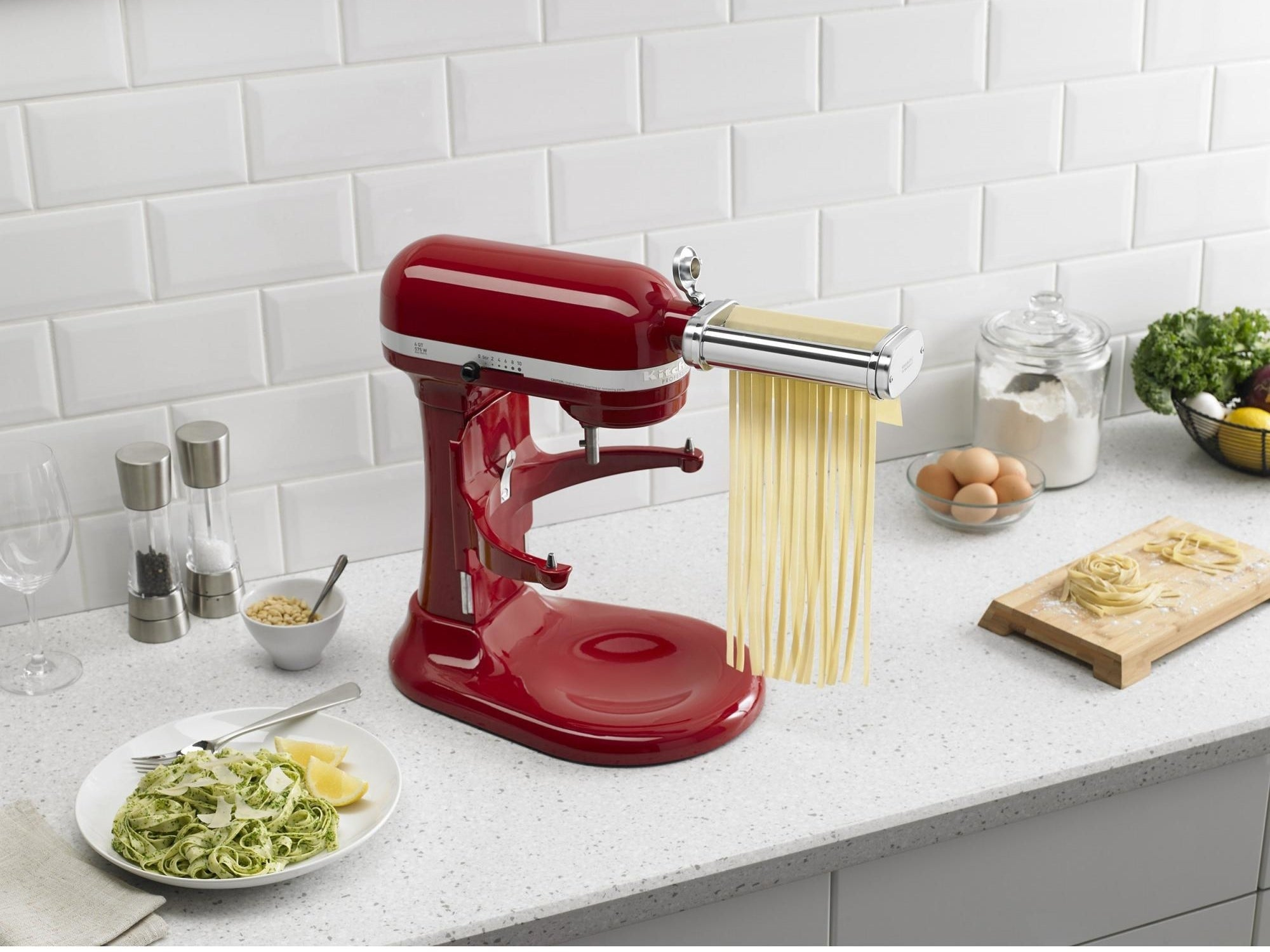 the attachment connected to the mixer making pasta