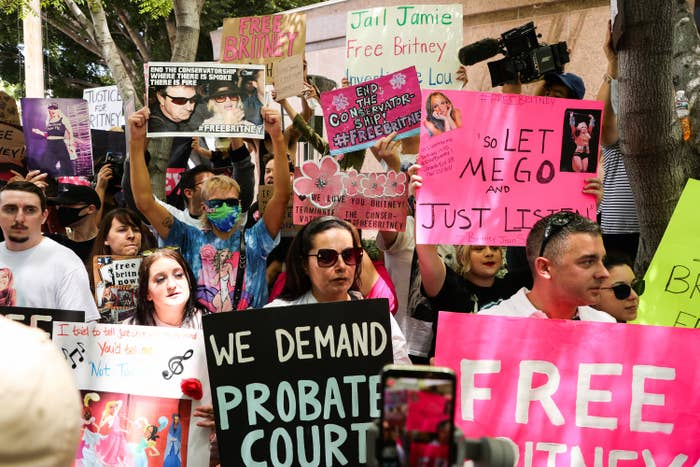 A group of fans hold up signs asking to free Britney